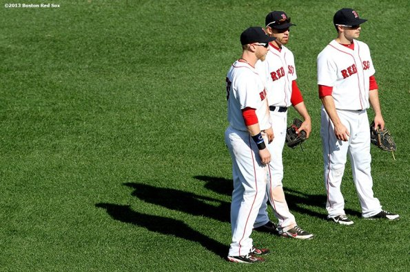 """""""Boston Red Sox outfielders Mike Carp (left), Jacoby Ellsbury (center), and Daniel Nava (right) meet during a pitching change in the  eighth inning of a game against the Los Angeles Angels of Anaheim Sunday, June 9, 2013 at Fenway Park in Boston, Massachusetts."""""""