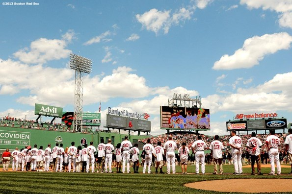 """""""The graduating class of Boston Red Sox scholars line up alongside Red Sox players during a pre-game ceremony Sunday, June 10, 2013 at Fenway Park in Boston, Massachusetts."""""""
