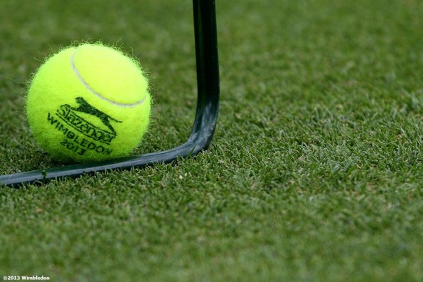 """""""An official Slazenger tennis ball is shown at the All England Lawn and Tennis Club in London, England Saturday, June 22, 2013 before the start of the 2013 Championships Wimbledon."""""""