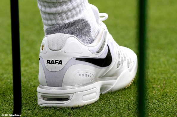 """""""The left shoe of Rafael Nadal is shown at the All England Lawn and Tennis Club in London, England Saturday, June 22, 2013 before the start of the 2013 Championships Wimbledon."""""""