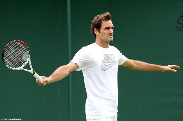 """""""Roger Federer gestures during a practice session at the All England Lawn and Tennis Club in London, England Saturday, June 22, 2013 before the start of the 2013 Championships Wimbledon."""""""