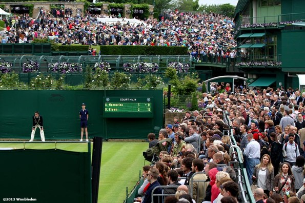 """""""Fans crowd No. 14 Court and Henman Hill at the All England Lawn and Tennis Club in London, England Friday, June 28, 2013 during the 2013 Championships Wimbledon."""""""