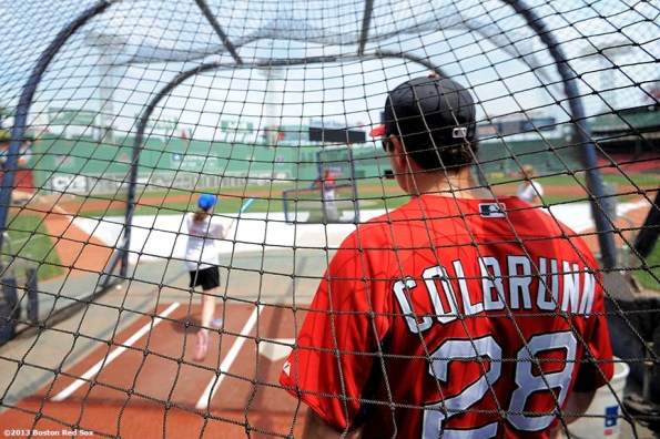 """""""Boston Red Sox hitting coach Greg Colbrunn watches as a CVS Hitting Clinic participant takes batting practice on the field at Fenway Park in Boston, Massachusetts Monday, July 22, 2013."""""""