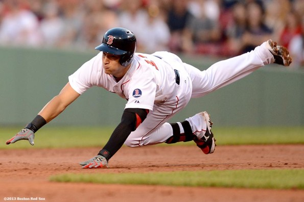 """""""Boston Red Sox infielder Jose Iglesias dives towards second base during the second inning of a game against the Seattle Mariners Tuesday, July 30, 2013 at Fenway Park in Boston, Massachusetts."""""""