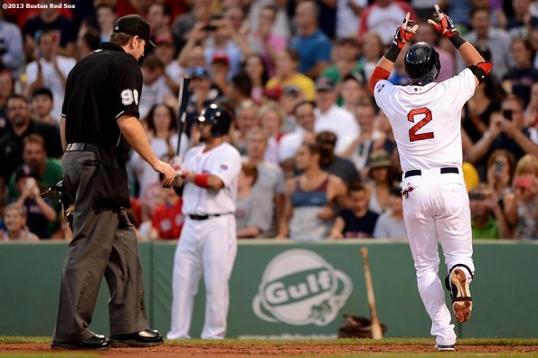 """""""Boston Red Sox icenter fielder Jacoby Ellsbury celebrates after hitting a solo home run during the second inning of a game against the Seattle Mariners Tuesday, July 30, 2013 at Fenway Park in Boston, Massachusetts."""""""