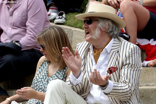 """""""A fan sits on the steps of Henman Hill at the All England Lawn and Tennis Club in London, England Monday, July 1, 2013 during the 2013 Championships Wimbledon."""""""