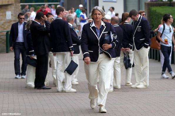 """""""A tournament referee walks away from a meeting at the All England Lawn and Tennis Club in London, England Monday, July 1, 2013 during the 2013 Championships Wimbledon."""""""