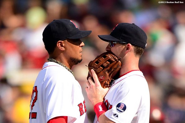 """""""Boston Red Sox pitcher Felix Doubront and shortstop Stephen Drew chat during the seventh inning of a game against the Arizona Diamondbacks Sunday, August 4, 2013 at Fenway Park in Boston, Massachusetts."""""""