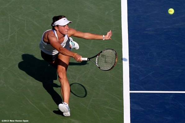 """""""Annika Beck lunges to return a serve from Petra Kvitova on Day 5 of the New Haven Open at Yale University in New Haven, Connecticut Tuesday, August 20, 2013."""""""