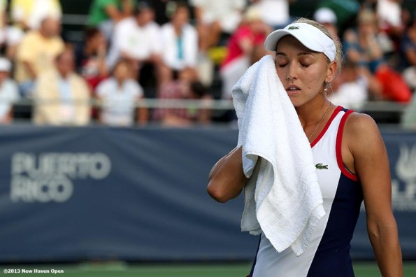 """""""Elena Vesnina wipes her face with a towel between points during a match on Day 7 of the New Haven Open at Yale University in New Haven, Connecticut Thursday, August 20, 2013."""""""