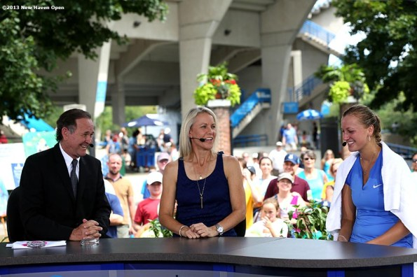 """""""Petra Kvitova (right) visits with anchors and Rennae Stubbs of ESPN on Day 8 of the New Haven Open at Yale University in New Haven, Connecticut Friday, August 20, 2013."""""""