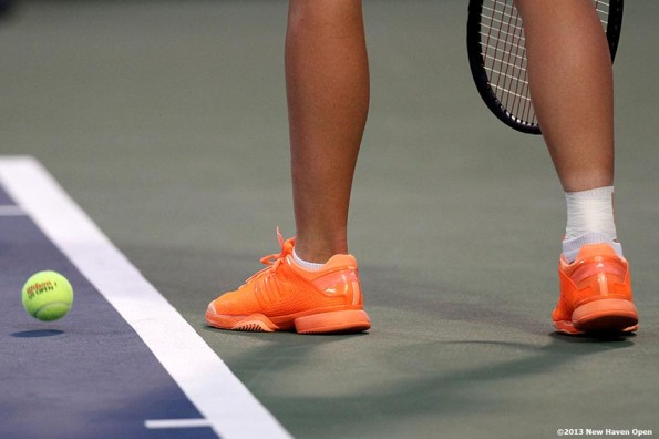 """""""The shoes of Caroline Wozniacki are shown as she prepares to serve during her semi-final match against Simona Halep on Day 8 of the New Haven Open at Yale University in New Haven, Connecticut Friday, August 20, 2013."""""""