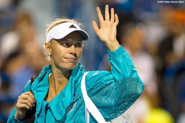 """""""Caroline Wozniacki waves to the crowd as she walks off Stadium Court after losing in the semi-finals to Simon Halep on Day 8 of the New Haven Open at Yale University in New Haven, Connecticut Friday, August 20, 2013."""""""
