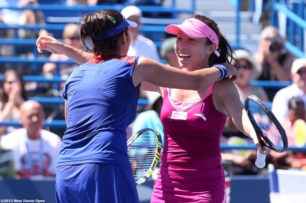 """""""Sania Mirza and Jie Zheng react after taking championship point to win the doubles title at the New Haven Open at Yale University in New Haven, Connecticut Saturday, August 24, 2013."""""""