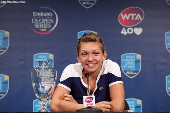 """""""Simona Halep speaks during a press conference after defeating Petra Kvitova to win the singles title at the New Haven Open at Yale University in New Haven, Connecticut Saturday, August 24, 2013."""""""