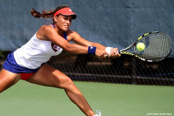 """""""Monica Puig returns a shot during her qualifying round match against Nadia Echeverria Alam on Day 1 of the New Haven Open at Yale University in New Haven, Connecticut Friday, August 16, 2013."""""""