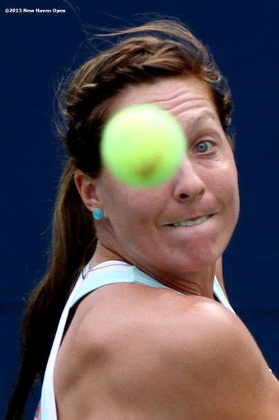 """""""Kelcy McKenna eyes a backhand return during a US Open National Playoff match on Day 1 of the New Haven Open at Yale University in New Haven, Connecticut Friday, August 16, 2013."""""""