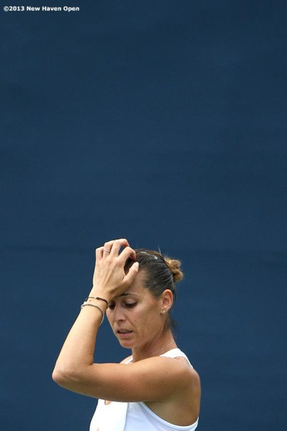 """""""Flavia Pennetta reacts after losing a point during a qualifying round match on Day 1 of the New Haven Open at Yale University in New Haven, Connecticut Friday, August 16, 2013."""""""