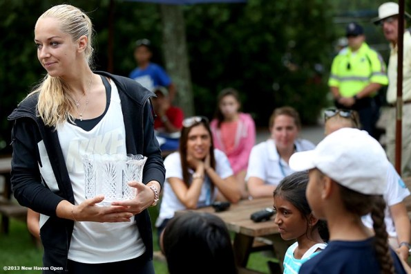 """""""2013 Wimbledon Ladies' Finalist Sabine Lisicki takes part in the main tournament draw ceremony on Day 1 of the New Haven Open at Yale University in New Haven, Connecticut Friday, August 16, 2013."""""""