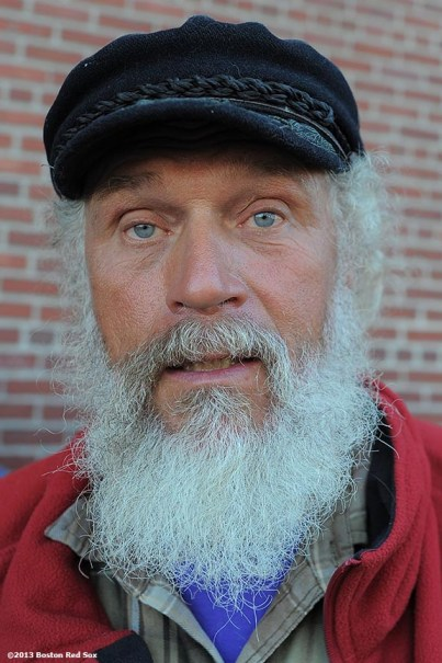 """""""A fan poses for a photograph as he lines up outside of Fenway Park in Boston, Massachusetts Wednesday, September 18, 2013 for Dollar Beard Night, a promotion which gave fans who attended the game with a beard or fake beard received a one dollar ticket."""""""