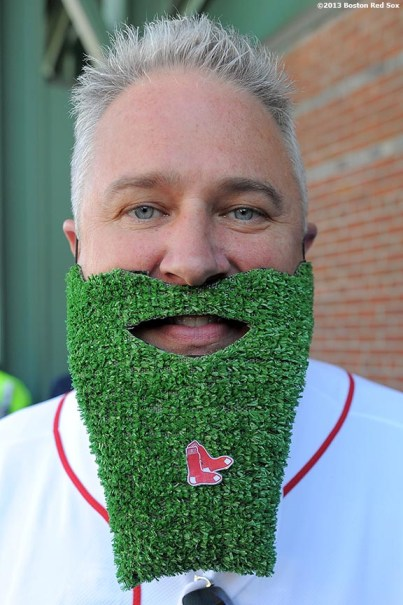 """""""A fan poses for a photograph as he lines up outside of Fenway Park in Boston, Massachusetts Wednesday, September 18, 2013 for Boston Red Sox Dollar Beard Night, a promotion which gave fans who attended the game with a beard or fake beard received a one dollar ticket."""""""