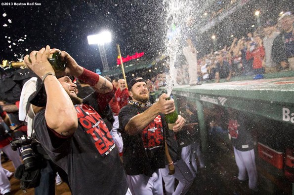 """""""Boston Red Sox pitchers Ryan Dempster and Brandon Snyder spray fans with champagne on the dugout during an on-field celebration after the Red Sox clinched the American League East title with a 6-3 win over the Toronto Blue Jays Friday, September 20, 2013 at Fenway Park."""""""