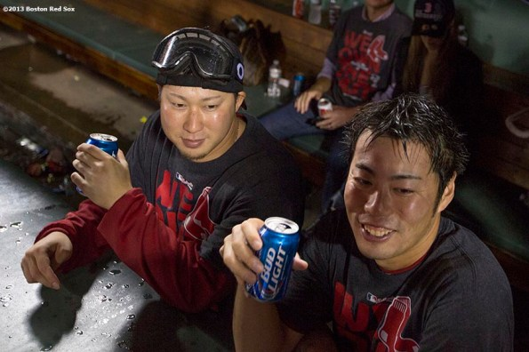 """""""Boston Red Sox pitchers Junichi Tazawa and Koji Uehara drink beer in the dugout during an on-field celebration after the Red Sox clinched the American League East title with a 6-3 win over the Toronto Blue Jays Friday, September 20, 2013 at Fenway Park."""""""