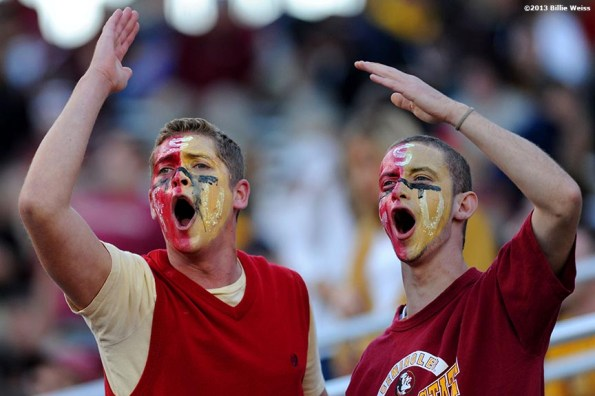 """""""Florida State fans lead a cheer during a game between the Florida State Seminoles and the Boston College Eagles at Alumni Stadium in Chestnut Hill, Massachusetts Saturday, September 28, 2013."""""""