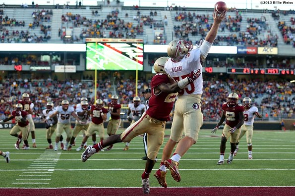 """""""Florida State Seminoles tight end Nick O'Leary attempts to catch a pass over linebacker Josh Keyes during the fourth quarter of a game against the Boston College Eagles at Alumni Stadium in Chestnut Hill, Massachusetts Saturday, September 28, 2013."""""""