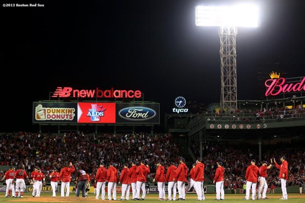 """""""Boston Red Sox players line up after defeating the Tampa Bay Rays in  Game One of the American League Division Series against the Tampa Bay Rays Friday, October 4, 2013 at Fenway Park in Boston, Massachusetts."""""""