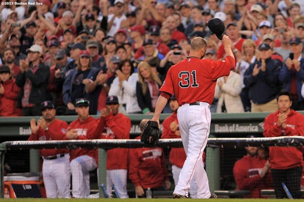 """""""Boston Red Sox pitcher Jon Lester tips his cap as he walks to the dugout during the eighth inning of Game One of the American League Division Series against the Tampa Bay Rays Friday, October 4, 2013 at Fenway Park in Boston, Massachusetts."""""""