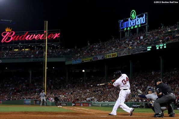 """""""Boston Red Sox designated hitter David Ortiz hits a home run during the eighth inning of game two of the American League Division Series against the Tampa Bay Rays Saturday, October 5, 2013 at Fenway Park in Boston, Massachusetts."""""""