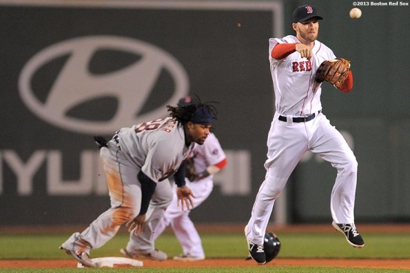 """""""Boston Red Sox shortstop Stephen Drew turns a double play during the third inning game one of the American League Championship Series against the Detroit Tigers Saturday, October 12, 2013 at Fenway Park in Boston, Massachusetts."""""""