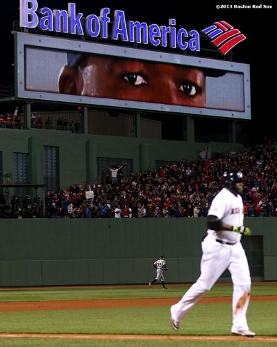 """""""The eyes of Boston Red Sox designated hitter David Ortiz are displayed on the video board at Fenway Park as he rounds the bases after hitting a game-tying grand slam home run during the eighth inning of game two of the American League Championship Series against the Detroit Tigers Sunday, October 13, 2013 at Fenway Park in Boston, Massachusetts."""""""