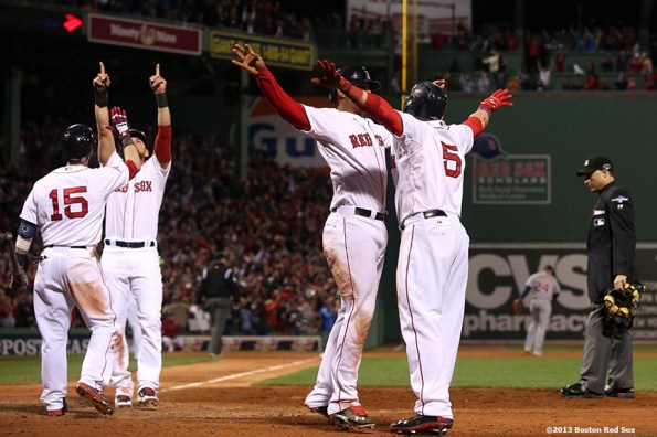 """""""Boston Red Sox center fielder Jacoby Ellsbury, second baseman Dustin Pedroia and left fielder Jonny Gomes celebrate after right fielder Shane Victorino hit a go-ahead grand slam home run during the seventh inning of game six of the American League Championship Series against the Detroit Tigers Saturday, October 19, 2013 at Fenway Park in Boston, Massachusetts."""""""
