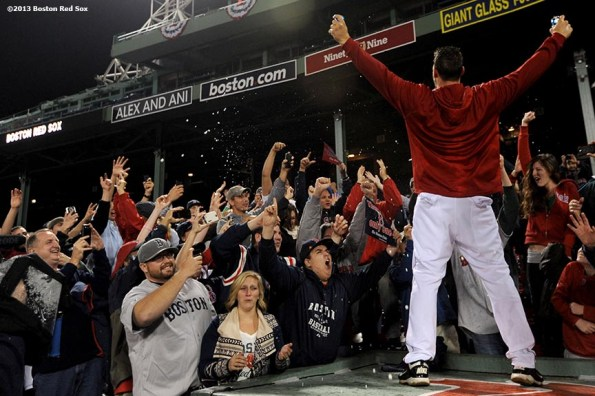 """""""Boston Red Sox catcher Ryan Lavarnway gestures to fans during an on-field celebration after winning game six of the American League Championship Series against the Detroit Tigers and advancing to the World Series Saturday, October 19, 2013 at Fenway Park in Boston, Massachusetts."""""""