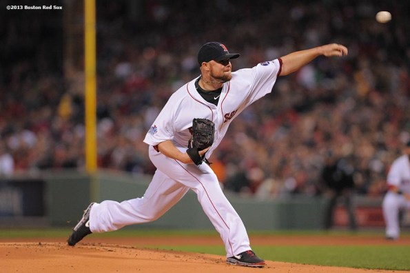 """""""Boston Red Sox pitcher Jon Lester delivers during the first inning of game one of the 2013 World Series against the St. Louis Cardinals Wednesday, October 23, 2013 at Fenway Park in Boston, Massachusetts."""""""