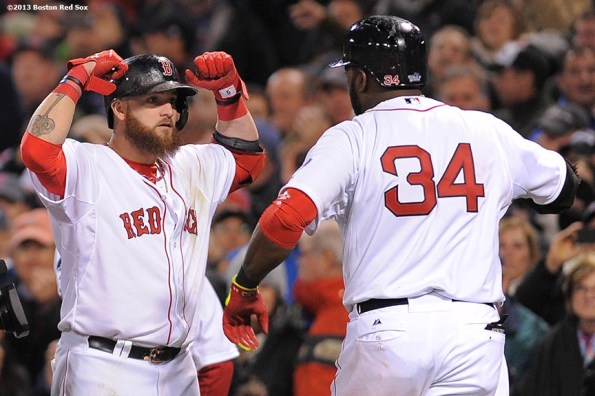 """""""Boston Red Sox right fielder Jonny Gomes celebrates with designated hitter David Ortiz after Ortiz hit a two run home run during the seventh inning of game one of the 2013 World Series against the St. Louis Cardinals at Fenway Park. Wednesday, October 23, 2013 at Fenway Park in Boston, Massachusetts."""""""