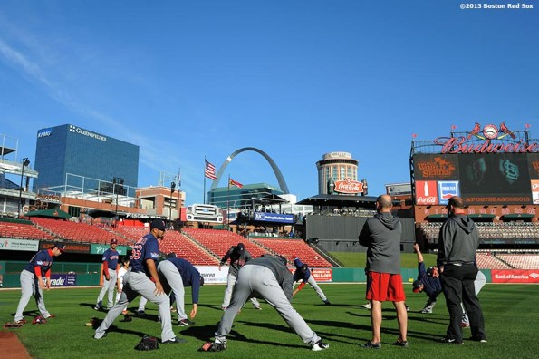"""""""Boston Red Sox pitchers stretch before game three of the 2013 World Series against the St. Louis Cardinals Saturday, October 26, 2013 at Busch Stadium in St. Louis, Missouri."""""""