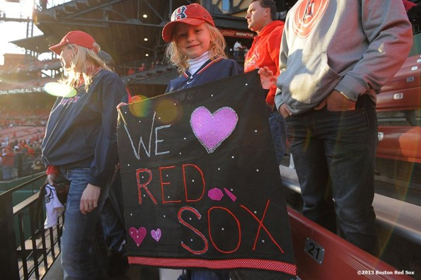 """""""A young Boston Red Sox fan poses for a photograph before game three of the 2013 World Series against the St. Louis Cardinals Saturday, October 26, 2013 at Busch Stadium in St. Louis, Missouri."""""""