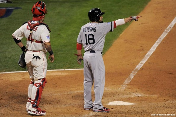 """""""Boston Red Sox right fielder Shane Victorino points as he scores during the eighth inning of game three of the 2013 World Series against the St. Louis Cardinals Saturday, October 26, 2013 at Busch Stadium in St. Louis, Missouri."""""""
