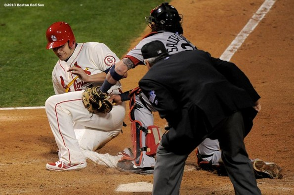 """""""Boston Red Sox catcher Jarrod Saltalamacchia tags out catcher Yadier Molina during the ninth inning of game three of the 2013 World Series against the St. Louis Cardinals Saturday, October 26, 2013 at Busch Stadium in St. Louis, Missouri."""""""