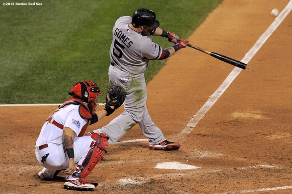 """""""Boston Red Sox left fielder Jonny Gomes hits a go-ahead three run home run during the sixth inning of game four of the 2013 World Series against the St. Louis Cardinals Sunday, October 27, 2013 at Busch Stadium in St. Louis, Missouri."""""""