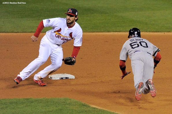 """""""Boston Red Sox pinch runner Quintin Berry steals second base during the eighth inning of game four of the 2013 World Series against the St. Louis Cardinals Sunday, October 27, 2013 at Busch Stadium in St. Louis, Missouri."""""""
