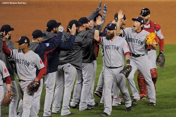 """""""Boston Red Sox players celebrate after winning game four of the 2013 World Series against the St. Louis Cardinals Sunday, October 27, 2013 at Busch Stadium in St. Louis, Missouri."""""""