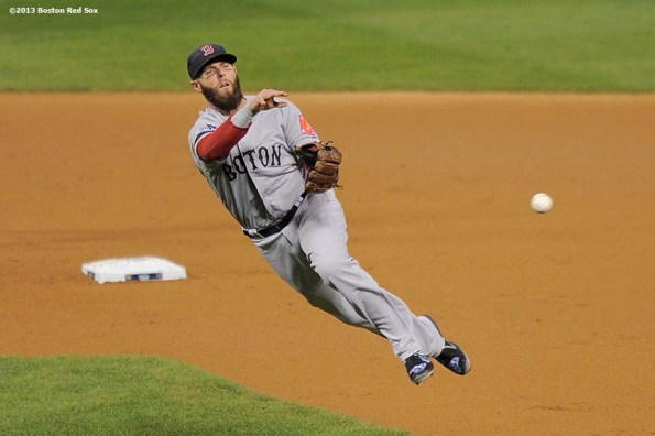 """""""Boston Red Sox second baseman Dustin Pedroia throws to first base during the first inning of game five of the 2013 World Series against the St. Louis Cardinals Monday, October 28, 2013 at Busch Stadium in St. Louis, Missouri."""""""