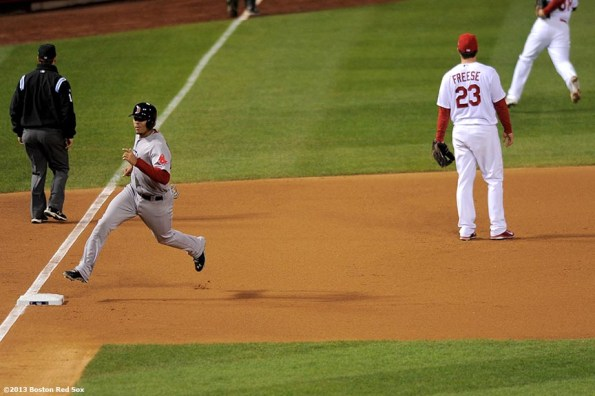 """""""Boston Red Sox third baseman Xander Bogaerts scores on an RBI double by catcher David Ross during the seventh inning of game five of the 2013 World Series against the St. Louis Cardinals Monday, October 28, 2013 at Busch Stadium in St. Louis, Missouri."""""""