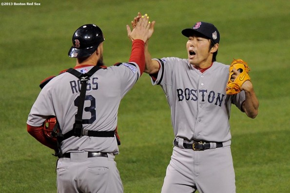 """""""Boston Red Sox pitcher Koji Uehara high fives catcher David Ross after recording the final out to defeat the St. Louis Cardinals 3-1 in game five of the 2013 World Series Monday, October 28, 2013 at Busch Stadium in St. Louis, Missouri."""""""