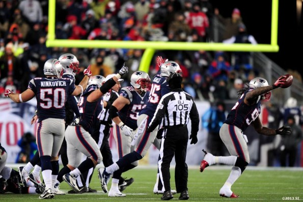 """""""New England Patriots players react after recovering a fumble against the Denver Broncos Sunday, November 24, 2013 at Gillette Stadium in Foxborough, Massachusetts."""""""