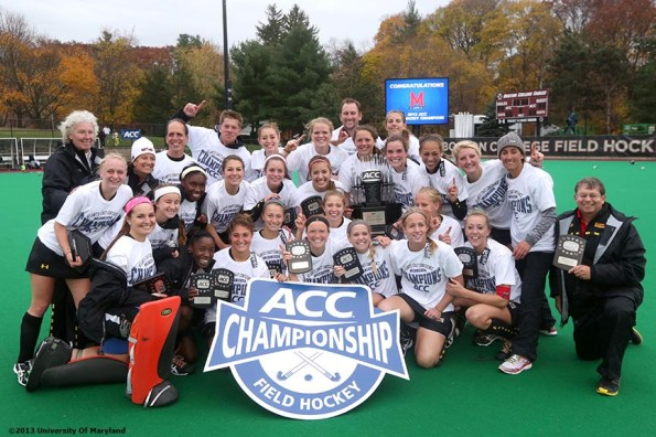 """""""The University of Maryland field hockey team poses for a photograph after defeating the University of North Carolina to win the ACC Field Hockey Conference Championship game against the University of North Carolina Sunday, November 10, 2013 at Boston College in Newton, Massachusetts."""""""
